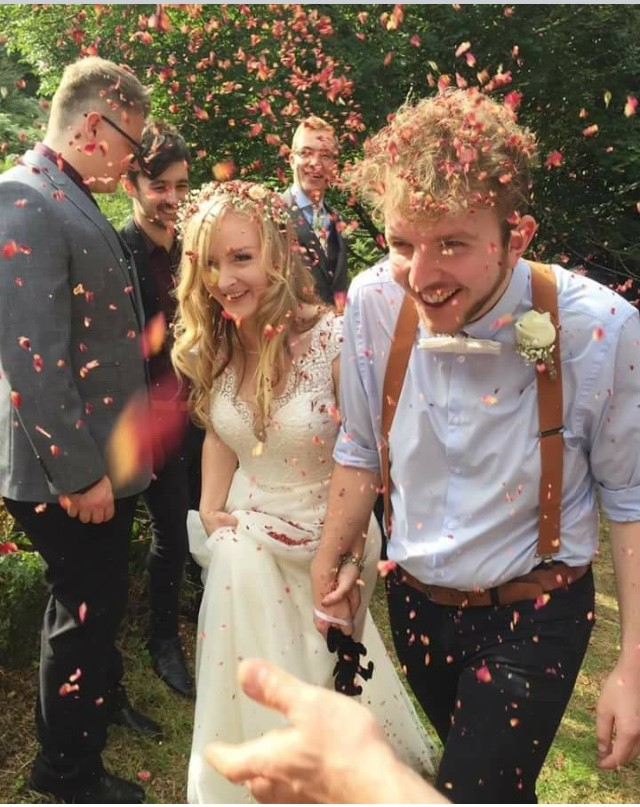 wedding ceremony with handfasting in woods