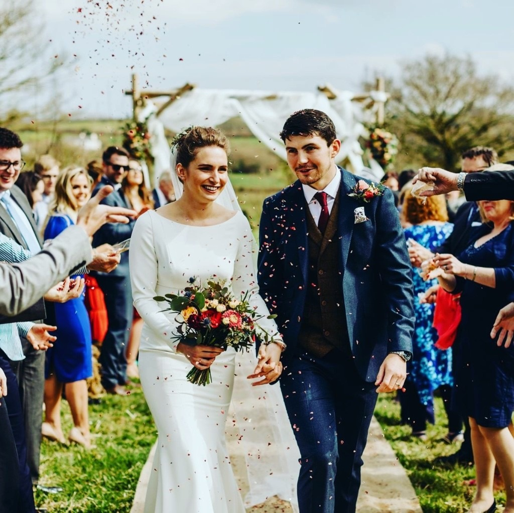Outdoor Wedding Ceremony in Devon with haybales